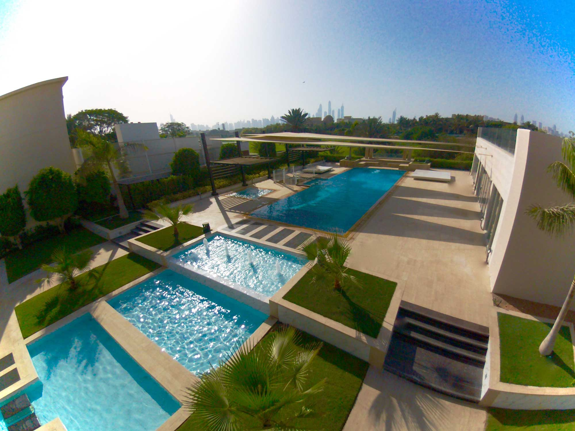 World class swimming pools based in uae absolute pools for Pool design dubai